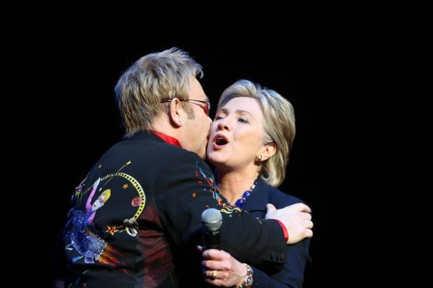 British songwriter Elton John embraces Democratic presidential contender Hillary Clinton at a fundraiser at Radio City Music Hall on April 9, 2008. - Photo by Andrew Theodorakis-Pool/Getty Images