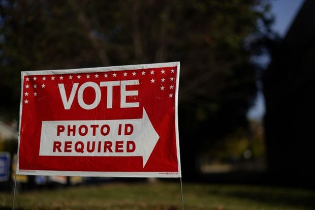 Photo ID required voting sign