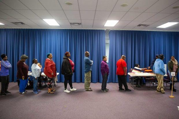 Voters wait in line in 2018