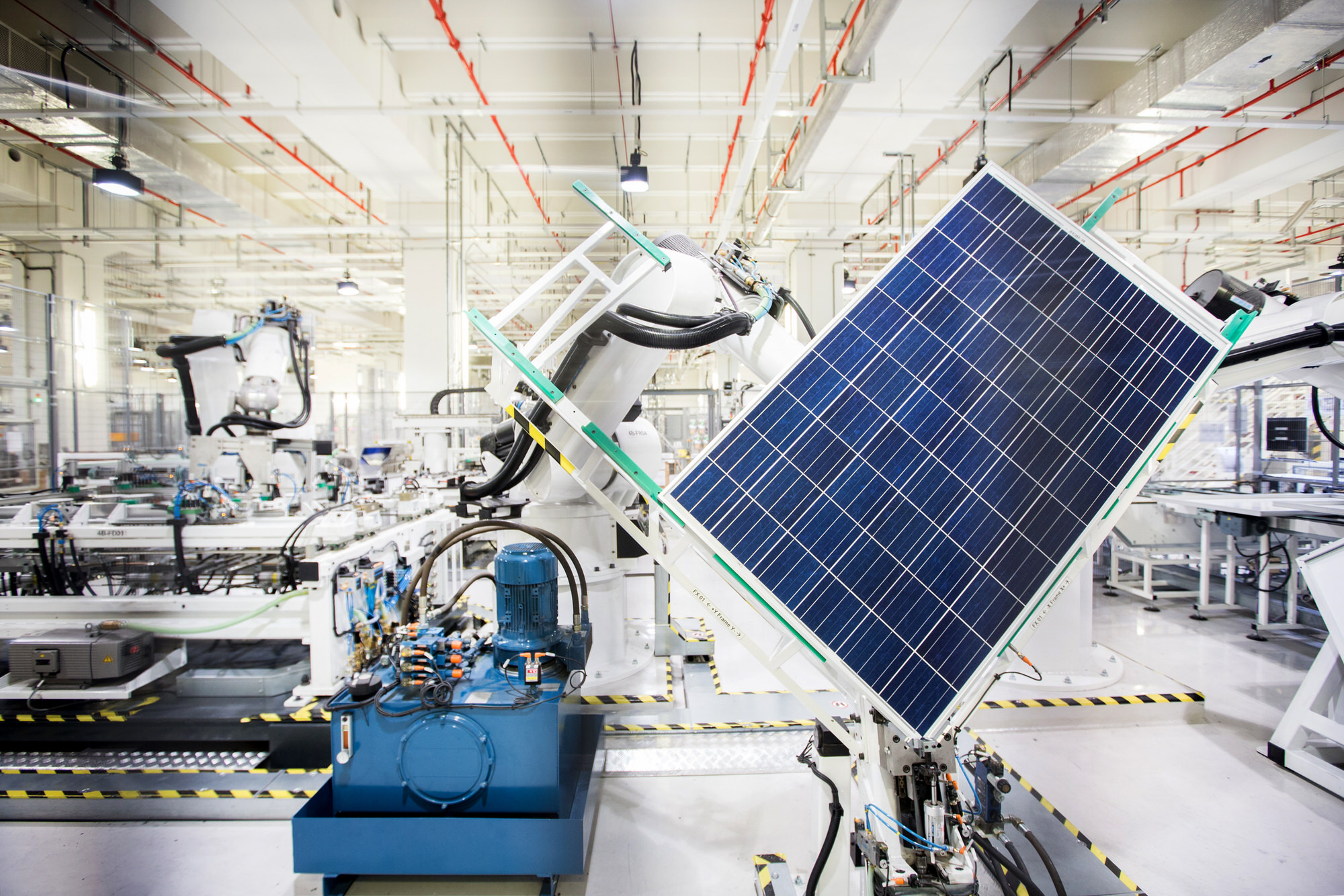 A robot handles a solar panel on the module production line at the REC Solar ASA manufacturing facility in Singapore, on Friday, Sept. 5, 2014. REC Solar has more than quadrupled to lead the 17-member Bloomberg Intelligence Global Large Solar Energy Index for the past year. Photographer: Nicky Loh/Bloomberg