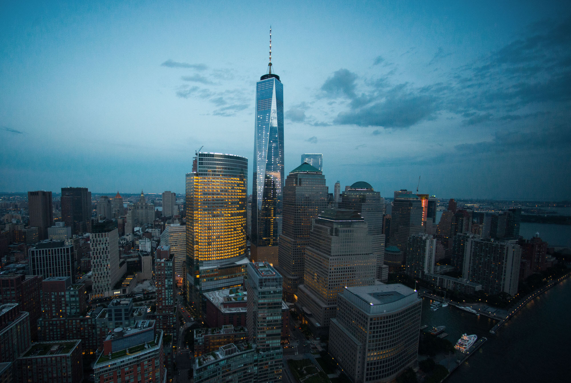 One World Trade Center stands the Lower Manhattan skyline at dusk in this aerial photograph taken above New York, U.S., on Friday, June 19, 2015. The Standard & Poor's 500 Index fell, with the gauge dropping below its price for the past 50 days, while Treasuries retreated. Photographer: Craig Warga/Bloomberg